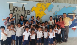 Amanda (L), Kong (R) and his wife Serena enjoying their time at the Shalom International School in Phnom Penh
